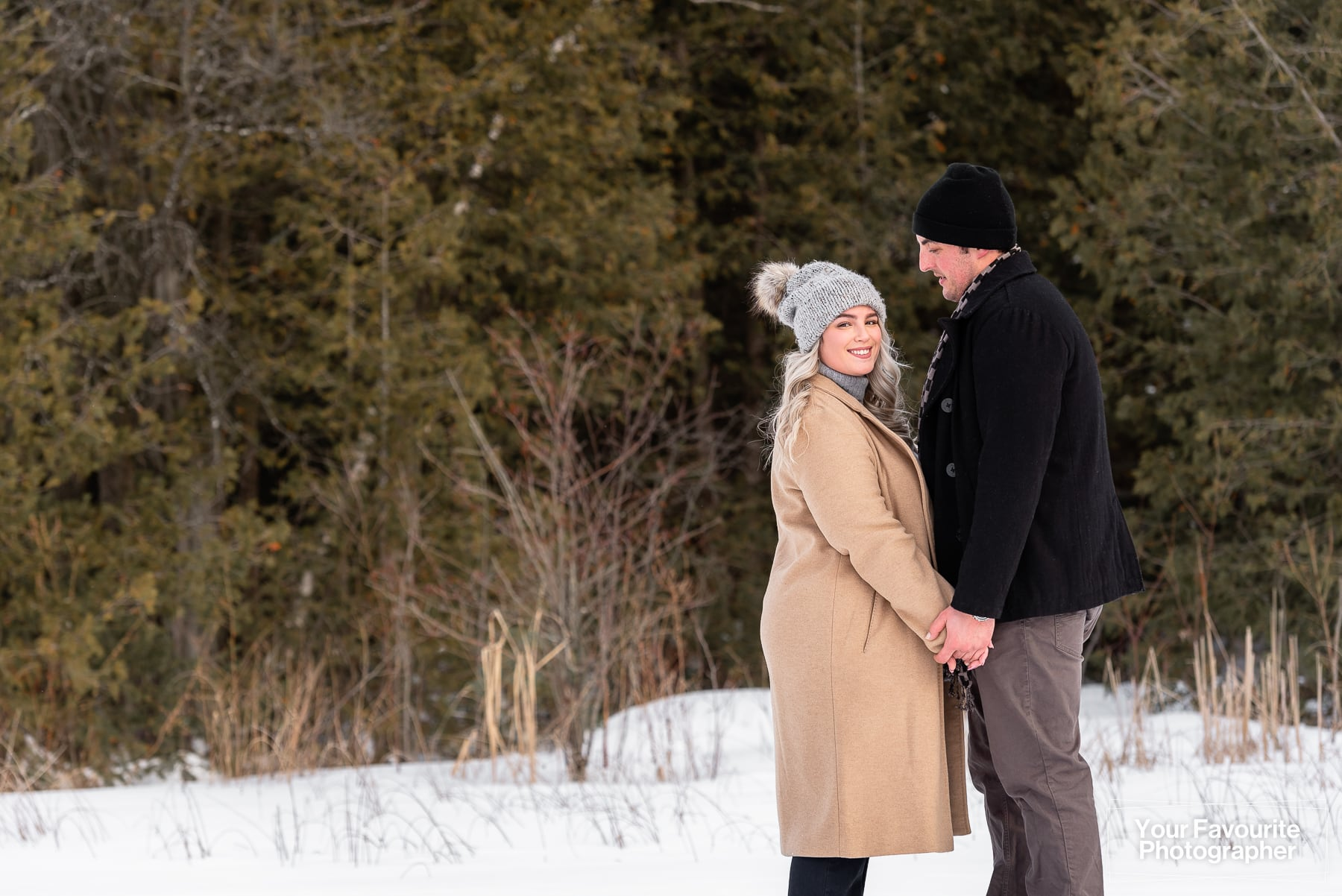 Frozen Lake Winter Engagement Photos in Port Perry with Maddie and Bryan