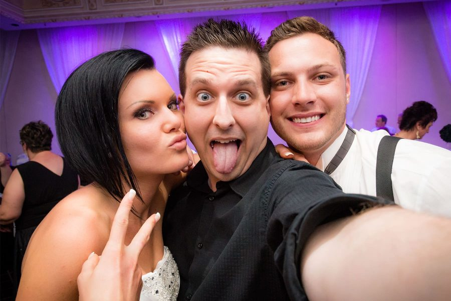 Toronto wedding photographer Ryan Visima poses for a selfie with Justine and Michael