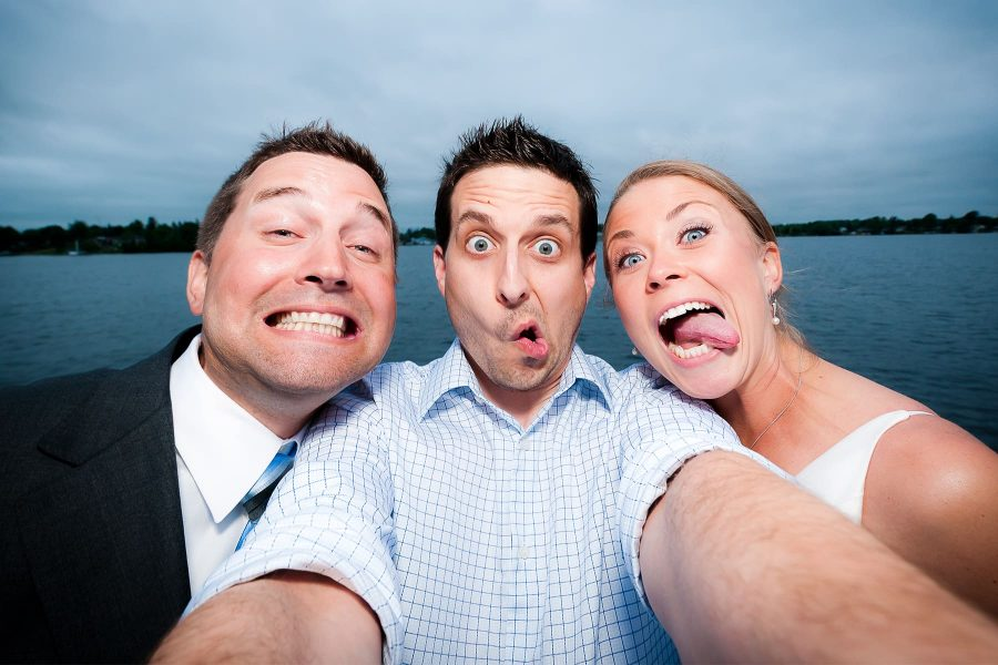 Toronto wedding photographer Ryan Visima poses for a selfie with Michelle and Matt