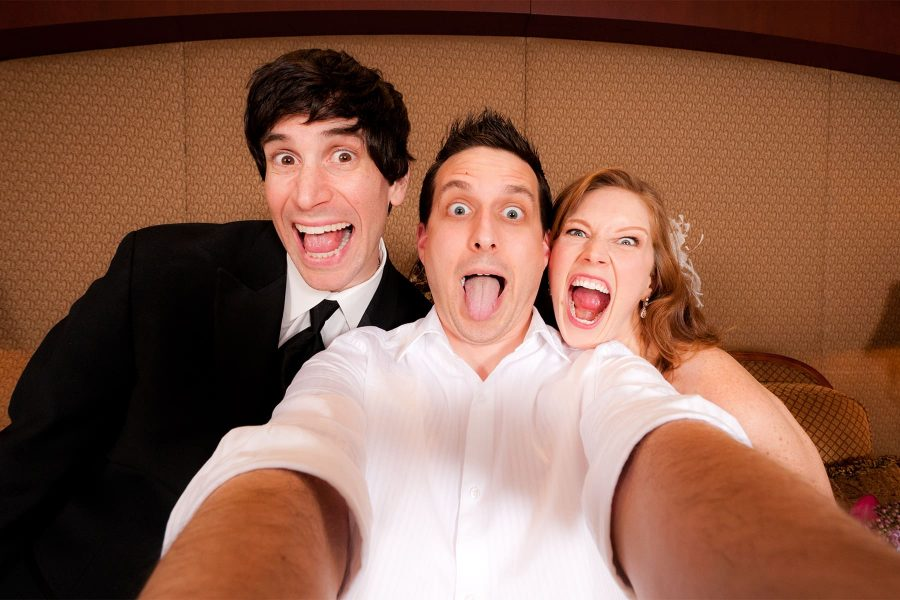 Toronto wedding photographer Ryan Visima poses for a selfie with Jordan and Emily